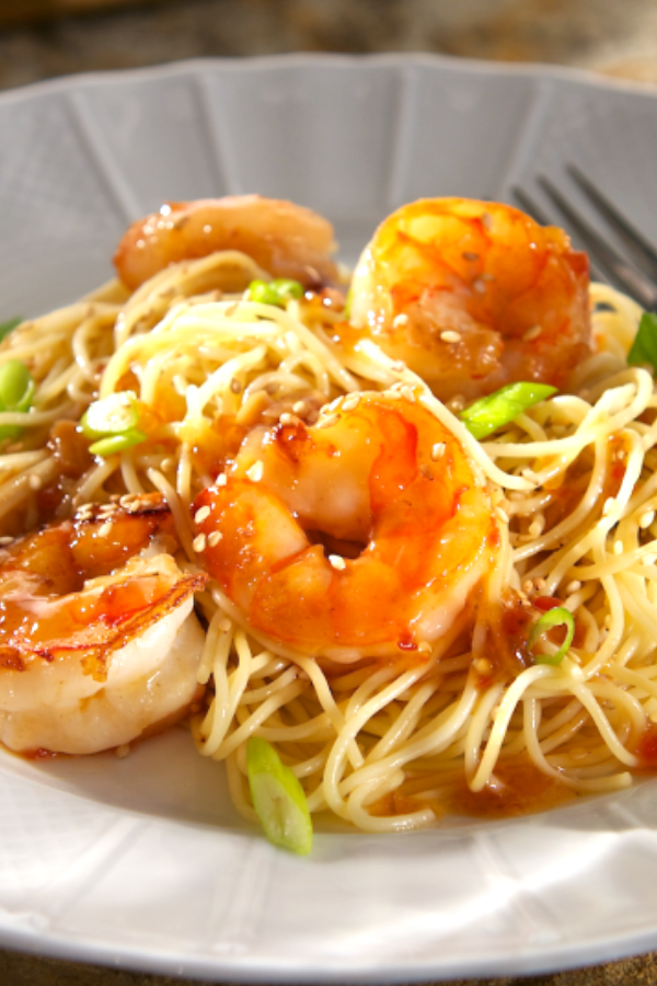 In little more than the time it takes to boil water you have got dinner on the table with this quick-to-fix Chili Garlic Shrimp with Sesame Noodles. #garlicshrimp #lemonbutter #shrimpscampi #recipe