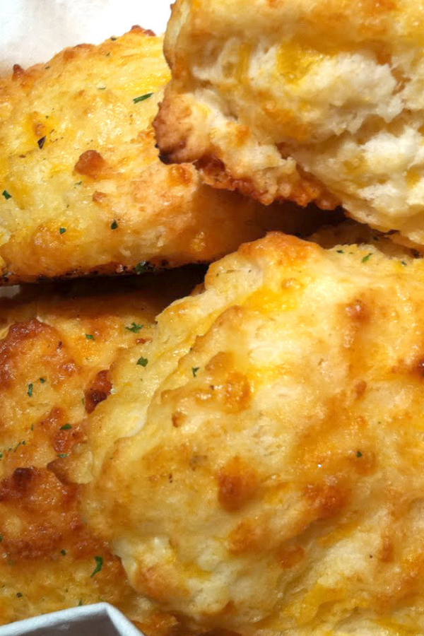 Every time we go to Red Lobster, there is one item that ALWAYS stands out…the biscuits. With this recipe you can make them at home. Just be sure that your baking powder is not expired, or you will end up with pancakes…not the warm fluffy pillows of goodness that you are craving. #cheddarbiscuits #biscuits #cheddarbaybiscuits #dinnerrolls #biscuitrecipe