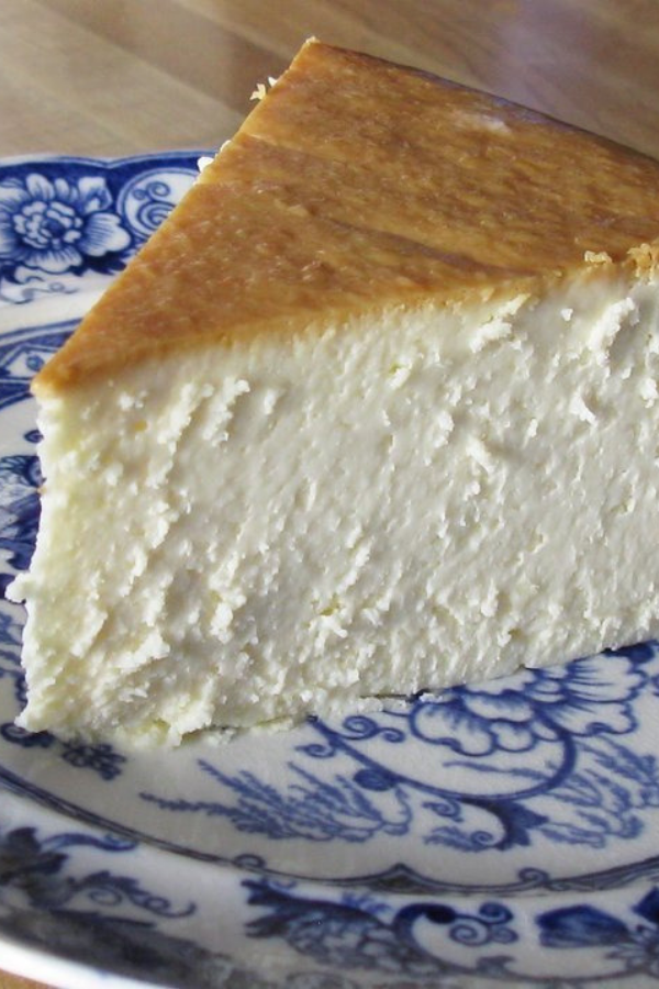 New York Cheesecake - This recipe for New York Cheesecake has become the favorite of family and friends who've had the good fortune to be served this slice of heavenly goodness. #dessert #cheesecake #perfectcheesecake #cherrycheesecake #plaincheesecake #desserts #nocrackcheesecake #flattopcheesecake #newyorkcheesecake #recipe #recipes