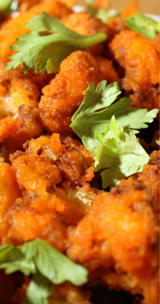 These Buffalo Fried Cauliflower bits are actually a pretty good knock off of boneless chicken wings. And here is a recipe that gives you a batch of hot, and a batch of mild 'wings'.